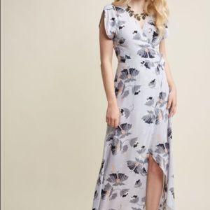 Flowy wrap dress with tulip sleeve.